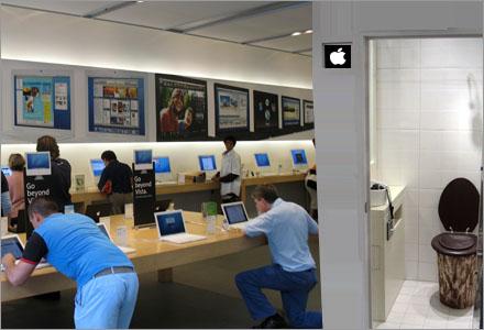 Apple-entusiasten i mitten hukar under bordet för att dölja sitt masturberande.